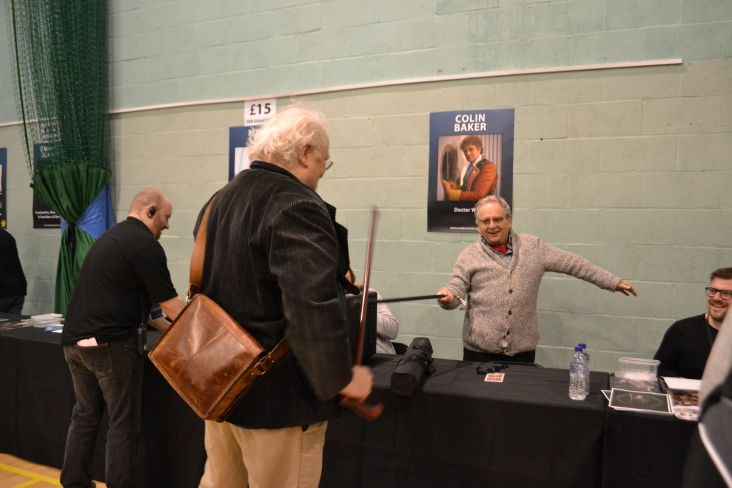 Colin Baker and Sylvester McCoy having a mock sword fight with their canes.
